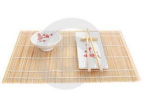 Sushi Plates And Chopsticks On Bamboo Mat Royalty Free Stock Photo - Image: 16088265