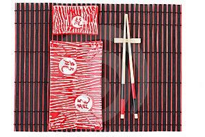 Sushi Plates And Chopsticks On Bamboo Mat Stock Photo - Image: 16088270