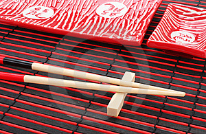Sushi Plates And Chopsticks On Bamboo Mat Royalty Free Stock Image - Image: 16088276