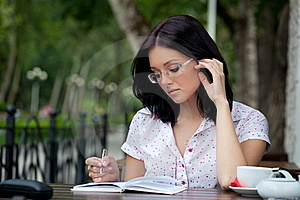 Girl With Notepad In Cafe Stock Image - Image: 16114501
