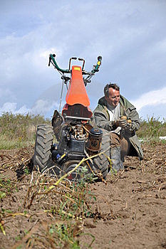 Farmer Plowing The Ground Stock Image - Image: 16118961