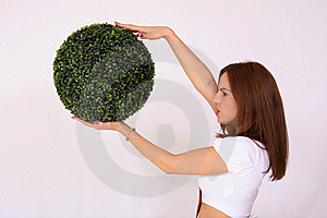 Girl Holding The Green Ball Royalty Free Stock Photography - Image: 16119937