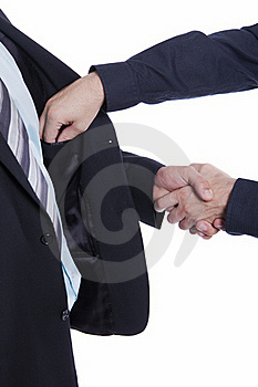 Businessman Shaking Hands, Other Hand In Pocket Stock Image - Image: 16126381