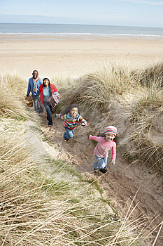 Family Walking Along Dunes On Winter Beach Stock Photography - Image: 16147082