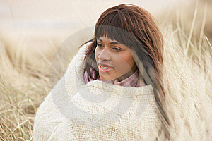 Woman Wrapped In Blanket Amongst Dunes On Winter B Royalty Free Stock Image - Image: 16150176