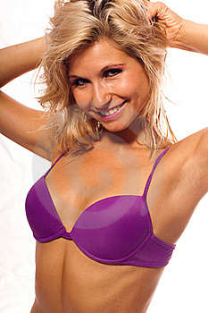 Sexy Girl In A Wet Violet Bikini Is Smiling Stock Photography - Image: 16152852