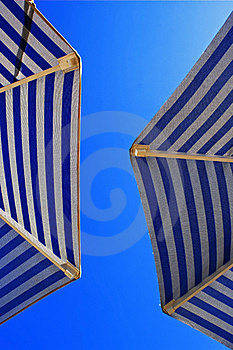 Sunshades Against The Blue Sky Royalty Free Stock Photos - Image: 16155388