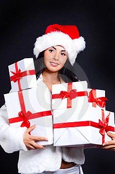 Santa Girl Holding A Lot Of Gifts. Royalty Free Stock Image - Image: 16158206