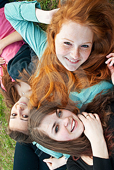 Three Different Girls Are Sitting On The Grass And Stock Photos - Image: 16163023