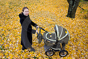 Mother With A Stroller. Stock Photos - Image: 16167073