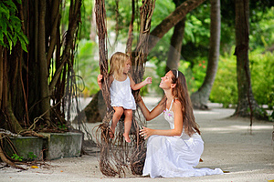 Mother And Her Little Daughter In Tropical Park Royalty Free Stock Images - Image: 16169499