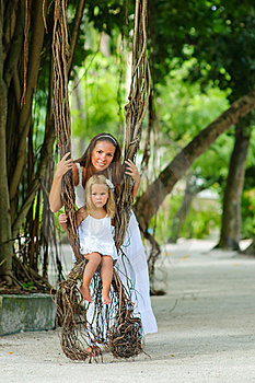 Mother And Her Little Daughter In Tropical Park Royalty Free Stock Image - Image: 16169516