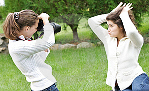 Girls Taking Pictures On Nature Stock Photo - Image: 16170270