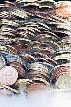 Shiny Euro Coins Frozen In Ice Royalty Free Stock Photography - Image: 16171747