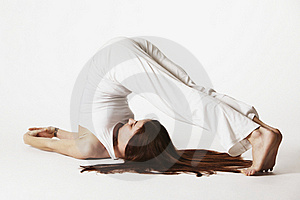 Woman In Plough Yoga Posture (Halasana) Royalty Free Stock Photos - Image: 16175668