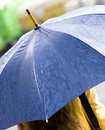 Woman with blue umbrella Royalty Free Stock Photography