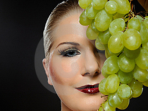Beautiful Woman With White Grapes Stock Image - Image: 16188501