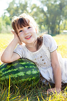 A Little Girl Lies On Watermelon Royalty Free Stock Image - Image: 16206666