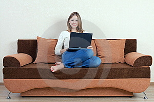 Woman With Laptop On The Sofa Stock Image - Image: 16216011