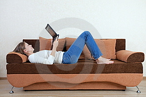 Woman With Laptop On The Sofa Stock Photos - Image: 16216103