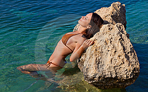 Girl Is Lying On Stone Royalty Free Stock Images - Image: 16220759