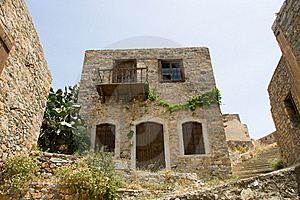 Picturesque Old Double-decker Lopsided Stone House Stock Images - Image: 16223864