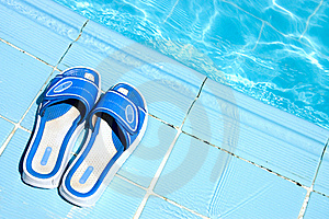Flip Flops By The Swimming Pool Royalty Free Stock Photos - Image: 16226558