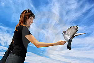 Girl Feeds The Dove Stock Image - Image: 16234911