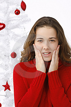 Beautiful Young Woman Next To Christmas Tree Royalty Free Stock Images - Image: 16247099