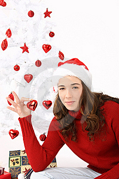 Woman Wearing Santa Hat Holding An Heart Royalty Free Stock Photo - Image: 16247305
