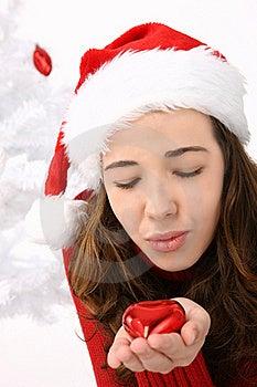 Woman Wearing Santa Hat Holding An Heart Stock Image - Image: 16247321