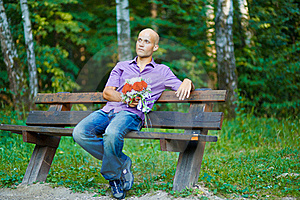 Guy With Bouquet Waiting For His Girlfriend Outsid Royalty Free Stock Photos - Image: 16248968