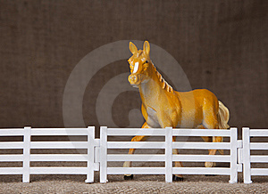 Toy Horse Behind Fence Stock Photography - Image: 16273002