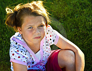 Beautiful Young Girl Unhappy On The Grass Royalty Free Stock Photography - Image: 16274177