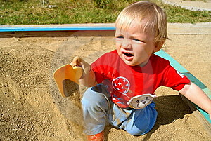 The Boy In A Sandbox Royalty Free Stock Image - Image: 16279876