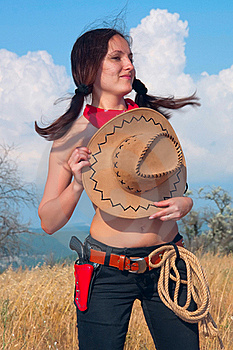 Girl Cowboy In The Field With  Hat On  Chest Stock Photos - Image: 16283323