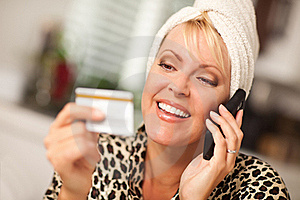 Smiling Robed Woman On Cell Phone With Credit Card Royalty Free Stock Images - Image: 16283849
