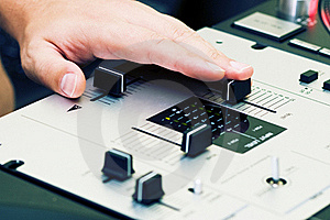 Hand Of A Dj Adjusting The Crossfader Royalty Free Stock Image - Image: 16294556