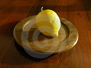 Lemon On Wooden Plate Stock Photography - Image: 16311372