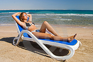 Cute Woman On A Plank Bed At The Sea Stock Photos - Image: 16316763