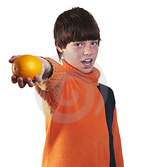 Boy Offers  Orange Stock Photos - Image: 16325463