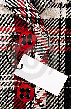 Blank Price Tag On Checked Coat With Red Buttons Stock Photography - Image: 16343672