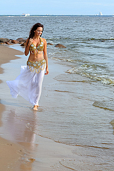 Beautiful Young Girl Walking On Beach Royalty Free Stock Photo - Image: 16348605