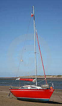 Red Yacht For Sale On The Beach Royalty Free Stock Photo - Image: 16351475