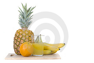 Variety Tropical Fruit With Glass Of Juice Royalty Free Stock Photos - Image: 16356998