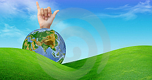 A Hand With A Globe And A Grass Field Stock Photo - Image: 16364280