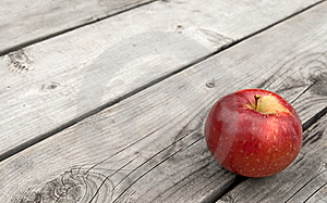 Red Apple On Old Wooden Table Royalty Free Stock Images - Image: 16369499