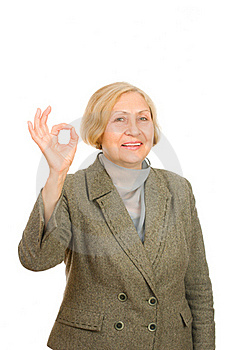 Smiling Senior Business Woman Showing Okay Symbol Royalty Free Stock Image - Image: 16383926