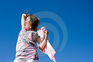 Happy Brunette Playing With A Scarf In The Summer Stock Photos - Image: 16388003