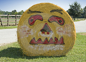 Pumpkin Face On Bale Of Hale Royalty Free Stock Photos - Image: 16391268